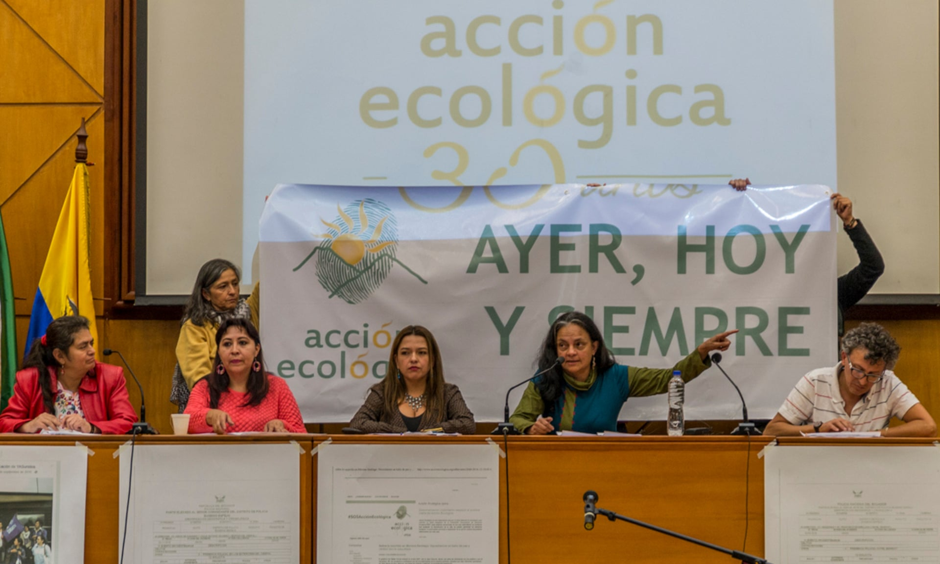 Acción Ecológica representatives speak in Quito yesterday before formally submitting their responses to the government's accusations. Photograph: Zitouna Auryn