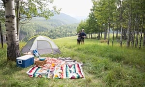 couple camping on hillside