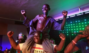 Mison Sere reacts, top, after winning the 2015 edition of the Mr Ugly competition, in Harare.