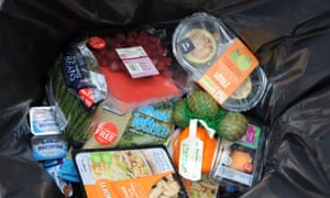 Out of date and unopened food thrown away in a dustbin. Nearly 100m tonnes of Europe's food is wasted each year.