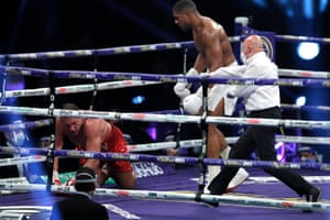 Pulev is knocked down by Joshua in the ninth.