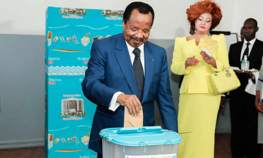 Paul Biya and his wife, Chantal, at a polling station in Yaoundé