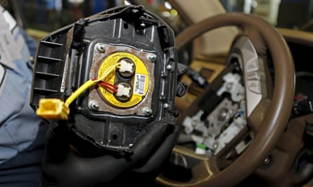A technician removes a recalled Takata airbag inflator