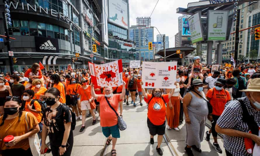 People march in the Every Child Matters March in Toronto, Canada, July 1, 2021, in honor of Indigenous children.