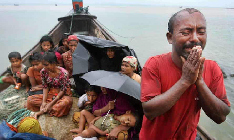 A Rohingya Muslim man who fled Myanmar to Bangladesh to escape religious violence, cries as he pleads from a boat after he and others were intercepted by Bangladeshi border authorities in Taknaf, Bangladesh.