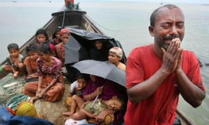 A Rohingya Muslim man who fled from Burma to Bangladesh to escape religious violence, cries as he pleads after being intercepted by Bangladeshi border authorities in June 2012.