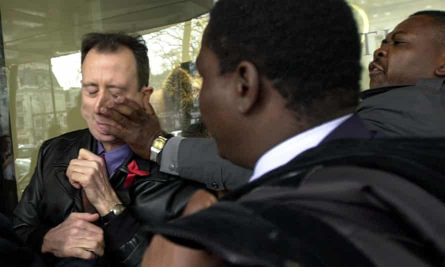 Peter Tatchell is attacked by Robert Mugabe's security guards