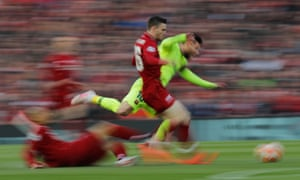 Fabinho and Andrew Robertson manage to stop Lionel Messi.