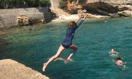 The writer's daughter leapsfrom Kardamyli jetty.