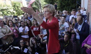 Democratic presidential candidate Sen. Elizabeth Warren addresses an overflow crowd during a campaign stop at town hall in New Hampshire.