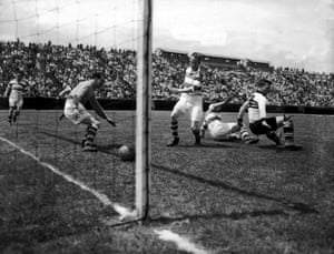 Belfast Celtic goalkeeper Kevin McAlinden and centre half Charlie Currie watch the ball head into the goal, during their 3-3 draw with Philadelphia Nationals on their 1949 tour of the USA.