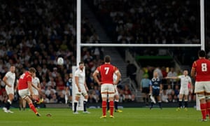 Dan Biggar of Wales kicks a penalty.