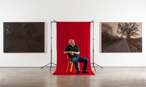 <strong>George Shaw photographed with his work at the Wilkinson Gallery in London