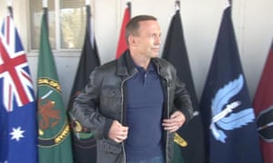 Tony Abbott wearing a bomber jacket at press conference in Iraq.