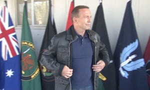 Tony Abbott wearing a bomber jacket at press conference in Iraq
