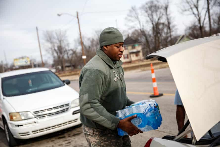 The national guard supplied bottled water to residents on 7 February 2016 in Flint, Michigan.