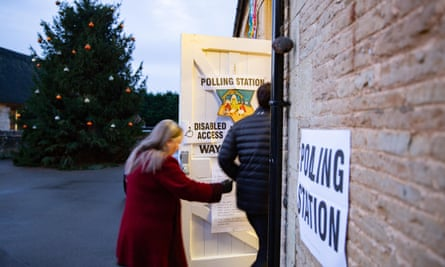Voters enter a polling station in Peterborough