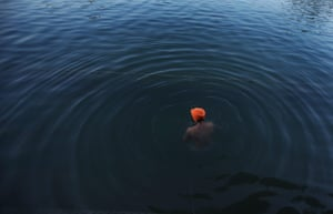 A Sikh man immerses himself in the sacred pond of the the Golden Temple during Diwali and Bandi Chorh Diwas celebrations.
