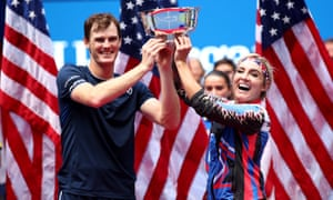Jamie Murray and Bethanie Mattek-Sands lift the trophy after their victory in the mixed doubles