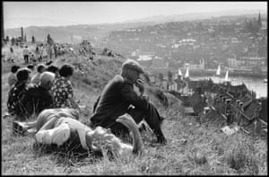 "Ian Berry: Whitby, UK, 1974Buy the printIan Berry writes: ""Long before Brexit, in simpler times, I took this photograph upon returning to England after a lengthy assignment. It's of Whitby in North Yorkshire, a place of flat caps and rich humour. Given a dry weekend, locals and visitors alike climb the hills overlooking the harbour to bask in the sunshine."""