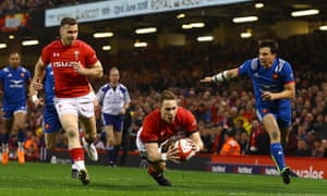 Liam Williams of Wales scores the opening try against France