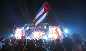 Fans wave the flag of Cuba at the Rolling Stones concert.