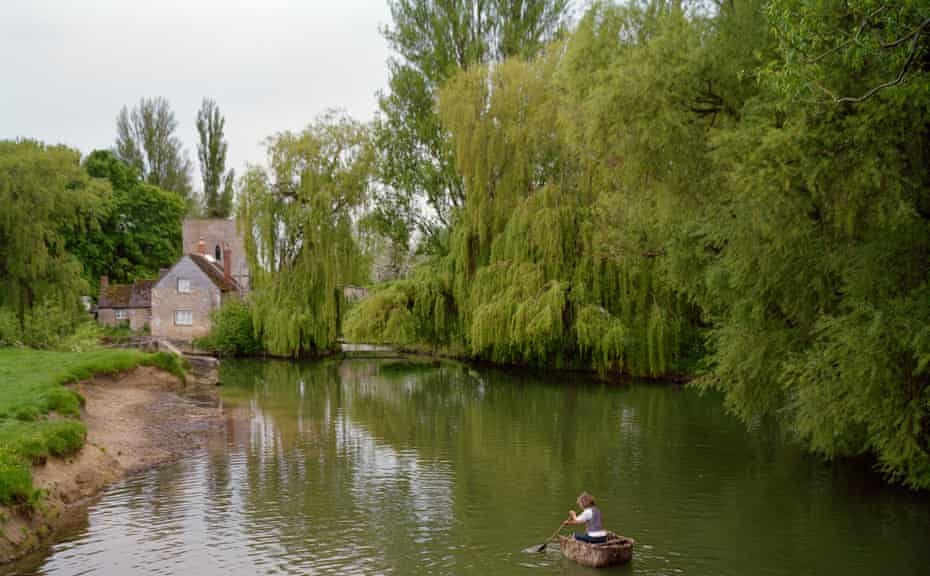 Documenting encounters and happenings ... druid Chris Parks rows his homemade coracle near Lechlade on the upper Thames.