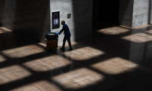 A custodian walks in the Senate office building on Capitol Hill in Washington DC Tuesday.
