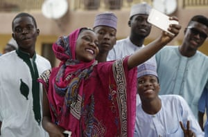 Lagos, Nigeria: A woman and her friends take a selfie