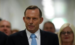Australian Prime Minister Tony Abbott and fellow Liberal MPs arrive for a special Liberal party room meeting at Parliament House in Canberra.
