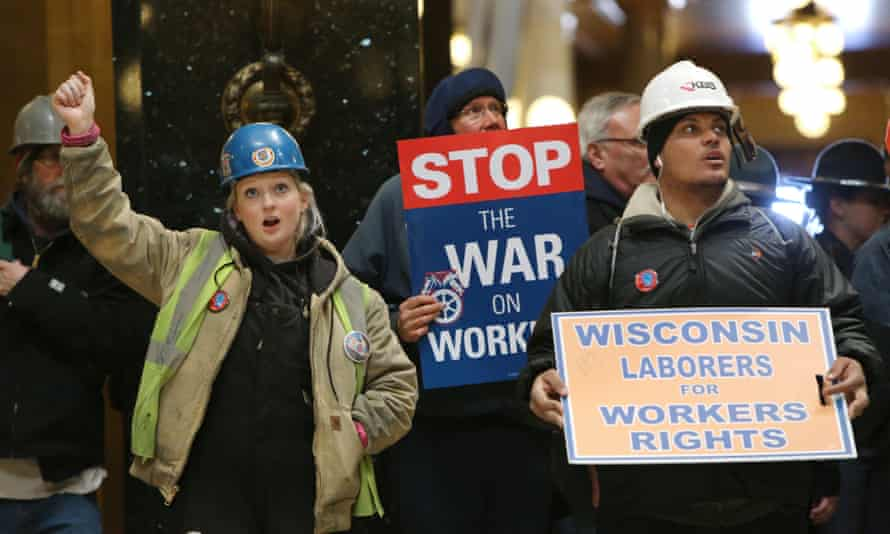 Workers protest in March 2015 inside the state capitol in Madison, Wisconsin, a state which has pioneered so-called 'right-to-work' legislation widely seen as an attack on unions.