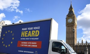 A van promoting an anti-Brexit rally drives past parliament