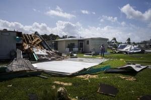Richard Klubb assesses the damage in the Tahiti mobile village in Estero