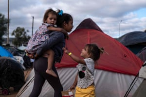 Children who have been walking for a month across Central America and Mexico in a temporary refuge in Tijuana.