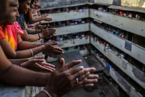 Residents bang utensils and applaud from the balconies to thank the medical staff , Mumbai, India