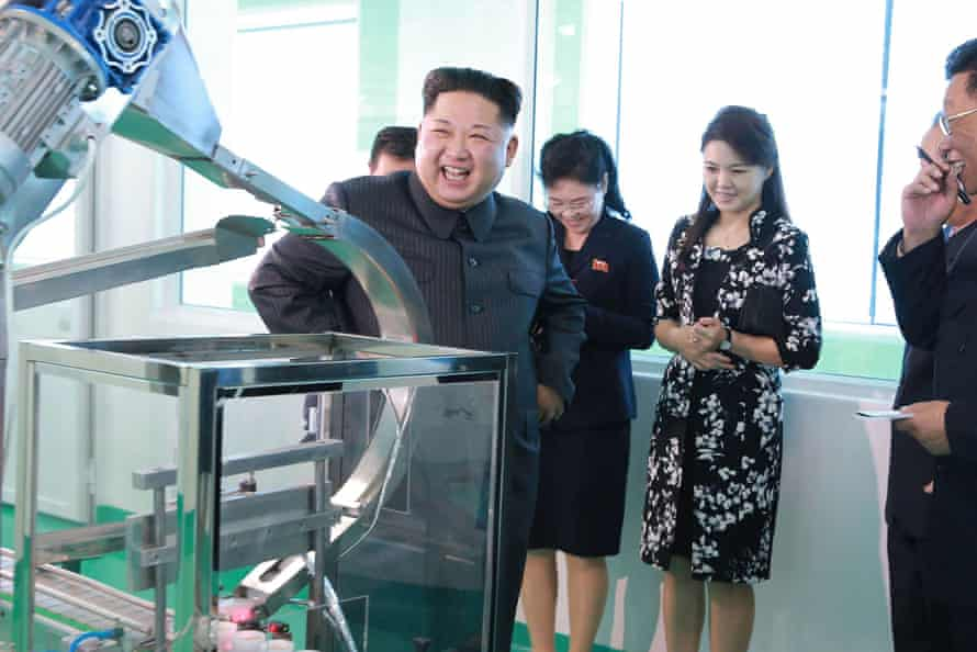 Kim watches a machine in action at the cosmetics factory.