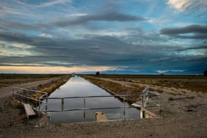 An irrigation channel stretches across the San Luis Valley
