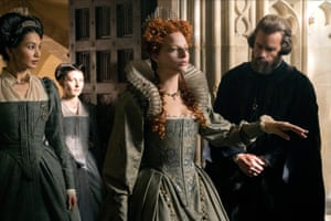 Gemma Chan, Margot Robbie and Guy Pearce in Mary Queen of Scots.
