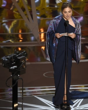 Anousheh Ansari accepts the award for best foreign language film for The Salesman on behalf of Asghar Farhadi, who was not present in protest in protest at President Trump's executive order that banned travel to the US from seven Muslim countries