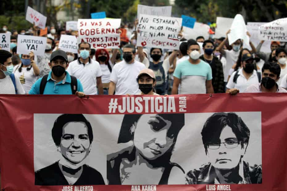Mexican students hold a sign depicting the murdered siblings Ana Karen, Luis Angel and Jose Alberto Gonzalez during the 'March of Peace and Justice' in Guadalajara on 11 May.