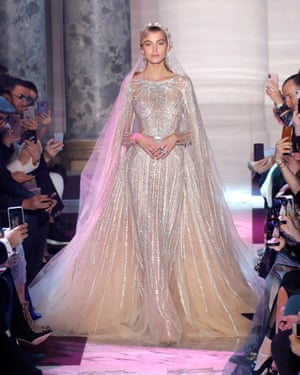 A model presents a wedding dress by designer Elie Saab