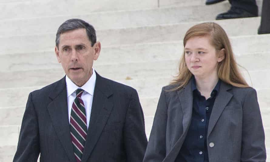 Abigail Fisher, who challenged the use of race in college admissions, right, walks with lawyer Edward Blum following oral arguments in the supreme court on 9 December.