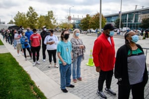 Indianapolis residents wait in line for upwards of two hours to cast early voting ballots for the US presidential election at the City Council building in Indianapolis.