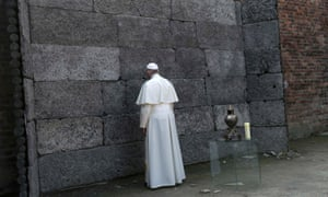 Pope Francis pays his respects at the 'wall of death'.