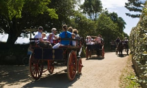 The people of Sark use horse-drawn carts, bicycles and tractors to get around as cars are banned.