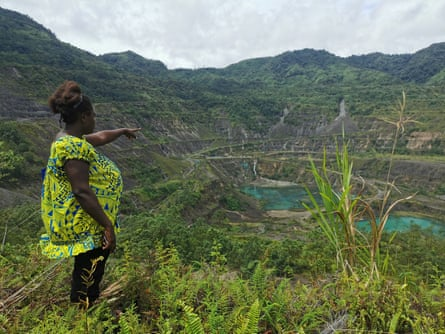 Theonila Roka Matbob stands in front of the Pangua mine in Konawiru, Bougainville.