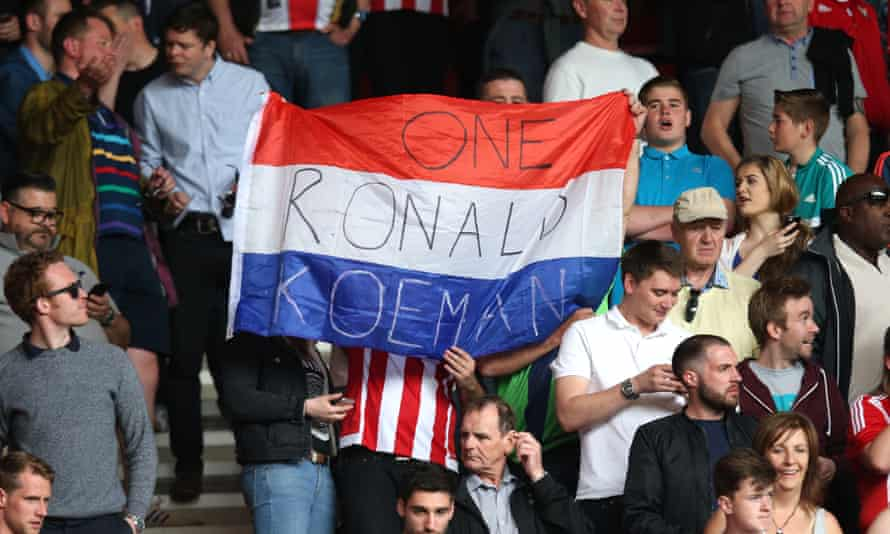 Southampton fans hold up a Dutch flag with Ronald Koeman's name at the end of the season finale against Crystal Palace
