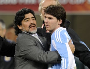 Diego Maradona hugs Lionel Messi after Argentina's 2010 World Cup quarter-final defeat to Germany in Cape Town