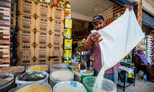 A merchant sells grains at a market in Qamishli in north-east Syria in September.