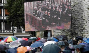 Mourners gather near a giant screen outside Rouen cathedral for the funeral service in memory of Father Jacques Hamel